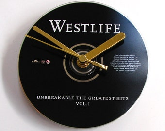 "WESTLIFE CD CLOCK. ""Unbreakable"", made from an original music cd album. Fun gift, pop, boy band, music wedding anniversary, black and silver"