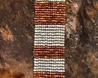 Striped peyote beaded bracelet, seafoam green and amber beads