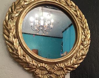 Gold Hollywood regency ornate mirror