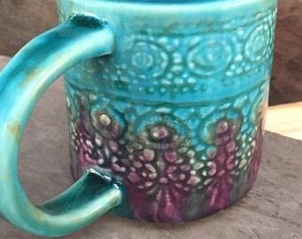 A beautiful turquoise & violet, sweet lace imprint handmade ceramic mug