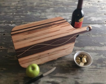 Ambrosia Maple serving board, stunning light and dark grain, with a hole to hang it