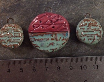 Scripted pendant and earring bead set.