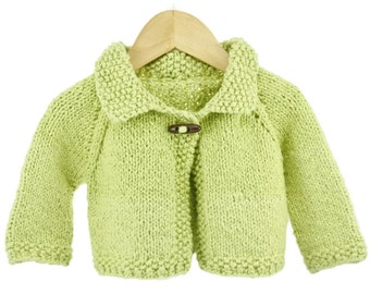 6 - 12 month size light green knitted organic cotton baby sweater