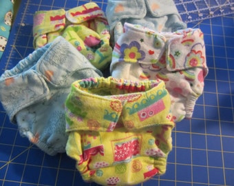 ONE cloth diaper, nb- size 1