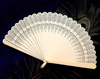 Fan, celluloid, vintage.  The fan is pale cream in colour with a lovely pierced floral design.   c1920's.