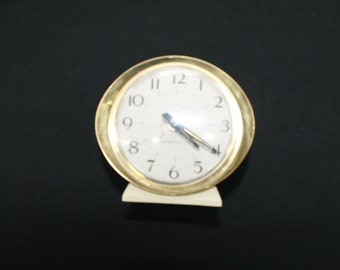 vintage Westclox small cream & gold metal Baby Ben alarm clock white face