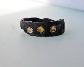 Irregular silver ring with 14 carat yellow gold