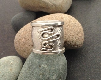 Very wide sterling silver tube ring, raised vines and leaves pattern, could be worn as midi ring, fits about size 5.5, slightly convex shape