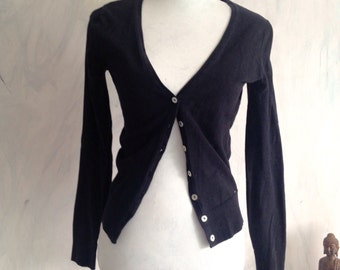 Black jacket with shell buttons