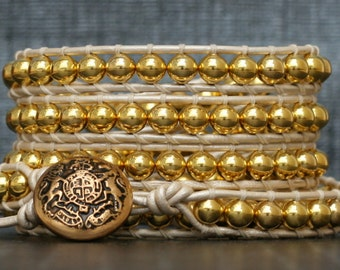 wrap bracelet- gold plated metal beads on pearl white leather