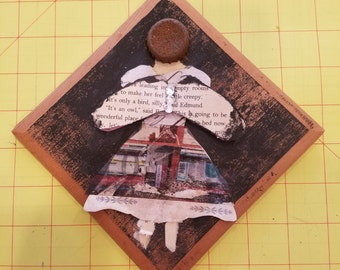 Upcycled angel plaque, bottle caps, old book pages, mixed media art