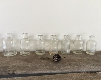 Bottles old vintage small miniature set of 7 clear glass rustic home decor