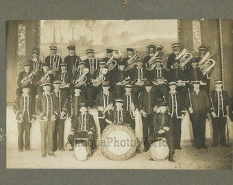 Wind music band in uniforms with uniforms and drum antique photo