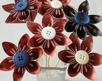 Handmade red and navy blue origami flowers with button centres