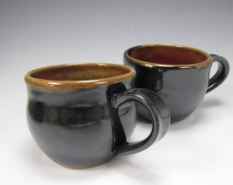Pair of handmade, stoneware coffee mugs. Two ceramic, tea cups