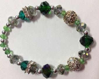"Green Chrystal Bling Bracelet Elastic easy on off Elastic Bracelet comfortably fits up to 6.5"" wrist"