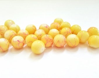 Pale Yellow with Pink Design Drawbench Glass Beads.  10mm in Size.  25 Beads Per Order.  Really Pretty and Colorful!!