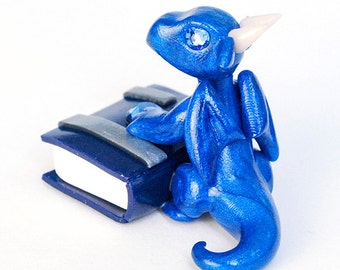 Random miniature dragon guarding a book - mystery listing - tiny clay dragon - geeky fantasy book lover gift - baby bookwyrm figurine