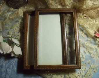 2 of former small frames with a trickle of marquetry.