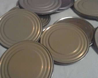 25 assorted  tin lids