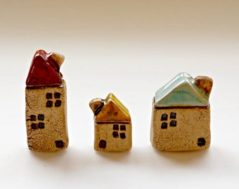 Set of 3 ceramic old look houses with colored roof and  metallic glaze.