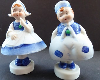 Pair of Vintage Japanese Bisque Nodder Figures of a Little DUTCH Boy and Girl. They wobble about from side to side, as if dancing!