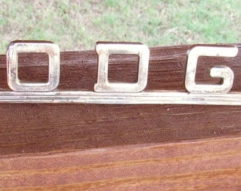 """Vintage metal """"Dodge"""" emblem, 8"""" wide"""