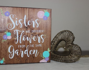 Sisters are Different Flowers from the same Garden Sign