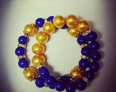 """Arm Candy. """"Lady Sigma"""" Antique Yellow and Royal Blue SGRHO stretch bracelet. Sigma Gamma Rho inspired."""