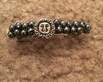 Sun barrette, hematite beads