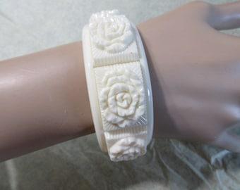 White Raised Rose Flowers Carved Vintage Plastic Bangle Bracelet Vintage 1970's Designer Signed Sarah