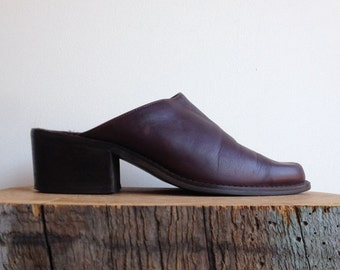 Leather mules. Stacked wood heel. Dark brown. Size 7