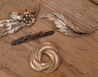 lot of four brooches, with one sterling silver