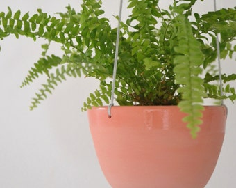 Hanging planter in coral