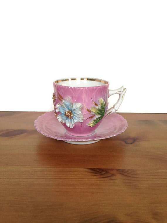 Raised floral tea cup with saucer high relief German porcelain teacup