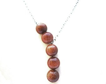 SIMPLICITY goldstone asymmetric necklace, 10 mm goldstone beads, stainless steel 316 l chain and finishing, statement necklace, natural stone