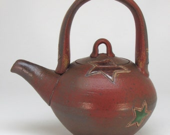 Red Teapot with Multicolored Stars