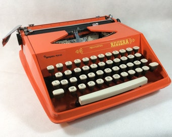 Vintage typewriter red portable working manual vintage Remington Riviera Carl Sundberg design for Sperry Rand 1960s