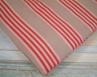 French vintage mattress ticking in beige pink and red stripes. Red stripe mattress ticking fabric. Vintage mattress fabric DIY projects.