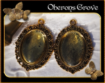 2 filigree settings gold with 25x18mm cabochons