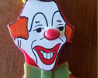 Vintage plastic clown magnet