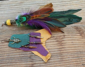 Shayan asymmetrical tribe native nomad primitive earrings with leather and feathers