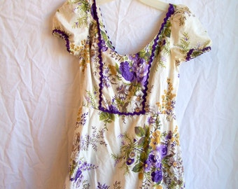 Purple flowered dress with rick rack trim and ruffles, empire waist