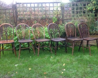 Six wheel back kitchen dining chairs