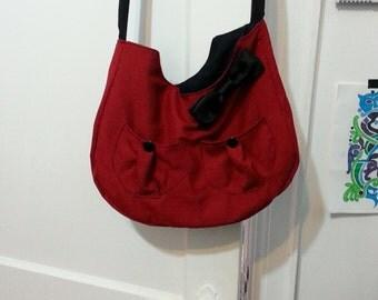 Small red messenger handbag