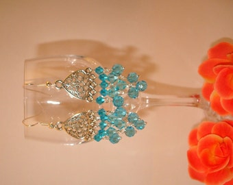 Dangling earrings with balls