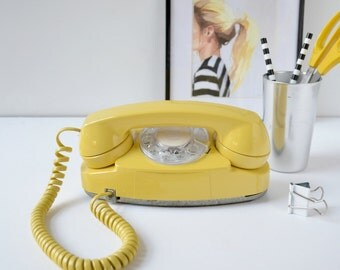 Rotary dial princess phone in yellow; working rotary dial princess phone; rotary phone; retro phone