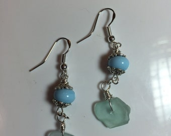 Dangly bead cap earrings with baby blue round lampwork beads with hanging light blue-green pieces of seaglass on sterling french earwires.
