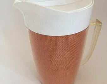 Vintage plastic wicker woven drink water pitcher
