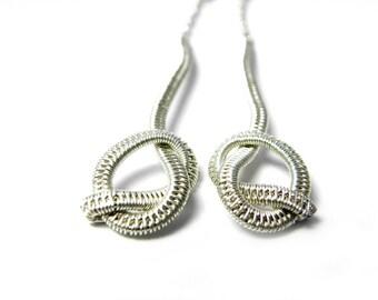Long knotted earrings Nenog in woven Sterling silver.
